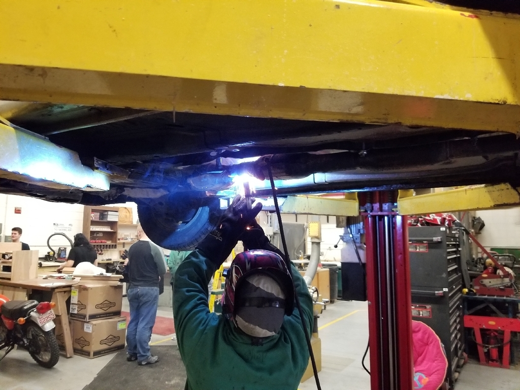 welding the muffler back together